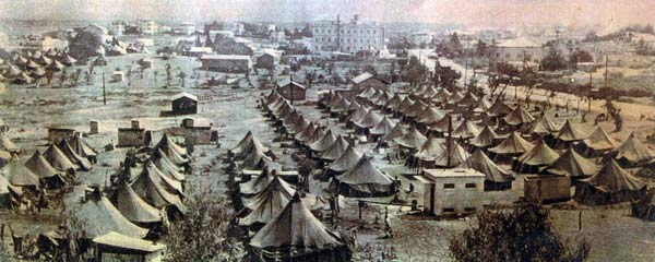 aviv-factory-with-immigrants-camp